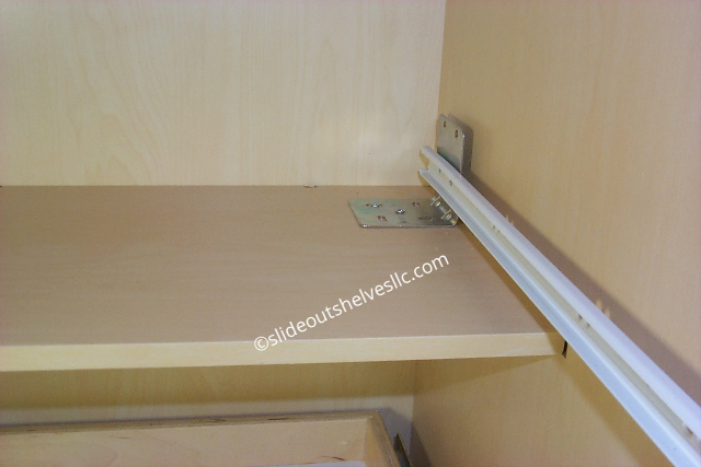 Pull out kitchen shelves slide attached to back shelf
