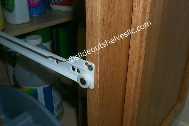 Pull out shelves drawer slide attached to kitchen cabinet front