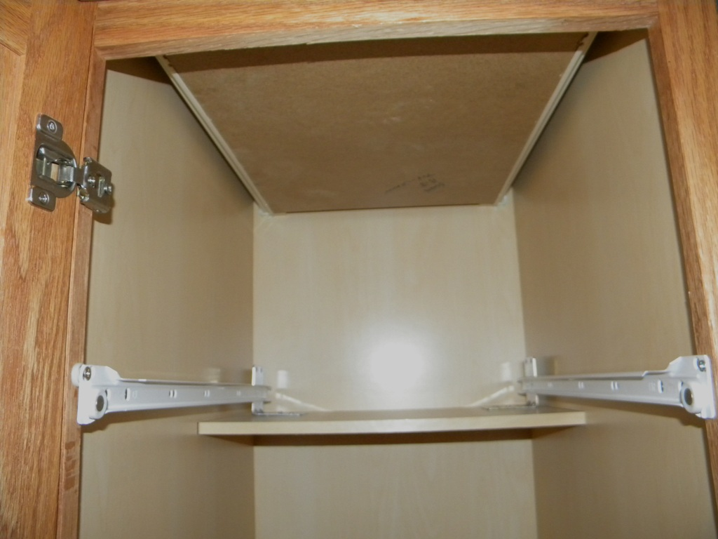 Pull out shelves installed on cabinet half shelf